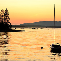 Sunset as seen from the harbor on Great Cranberry Island in Maine. Near Acadia National Park.