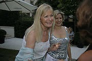 Debbie Moore and Penny Smith,  Ruinart party at The Hempel, Hempel Gardnes.  Craven Hill Gardens. 18 July 2006. <br />ONE TIME USE ONLY - DO NOT ARCHIVE  © Copyright Photograph by Dafydd Jones 66 Stockwell Park Rd. London SW9 0DA Tel 020 7733 0108 www.dafjones.com