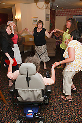 People with disabilities with carers enjoy dancing on holiday in Blackpool.