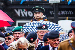 © Licensed to London News Pictures. 11/11/2018. Doncaster UK. A little boy watches the Service of remembrance at the Cenotaph in Doncaster to mark the 100th anniversary of the end of the First World War. Photo credit: Andrew McCaren/LNP