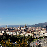 FLORENCE, ITALY - OCTOBER 31: <br /> A person taking a picture with a smart phone showing a panoramic view of Florence showing Florence's Cathedral, Basilica di Santa Maria del Fiore, known as Duomo in Florence, Italy. The Duomo is the main church of the city of Florence. Construction was started in 1296 in the Gothic style with the structure completed in 1436. The famous dome was designed by Arnolfo di Cambio and engineered by Filippo Brunelleschi. Florence, Italy, 31st October 2017. Photo by Tim Clayton/Corbis via Getty Images)