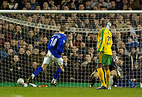 Photo. Jed Wee.<br /> Everton v Norwich City, FA Cup 3rd Round, Goodison Park, Liverpool. 03/01/2004.<br /> Everton's Duncan Ferguson sends Norwich keeper Robert Green the wrong way to score his second goal.