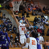 Gallup Bengal Khohanon Atazhoon (23) drives to the basket during a varsity basketball game against cross town rival Miyamura Patriots Tuesday evening at Gallup High School in Gallup.
