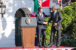 October 18, 2016 - Washington, DC, United States - On the South Lawn  of the White House in Washington, D.C., U.S., on Tuesday, Oct. 18, 2016., (l-r), Italian Prime Minister Matteo Renzi shakes hands with President Barack Obama, after speaking at the Official State Visit. This was the last Official State Visit for the Obama administration. (Credit Image: © Cheriss May/NurPhoto via ZUMA Press)