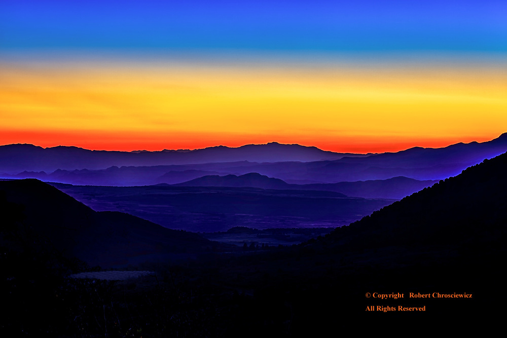 Last Remnants of the Day:The skies' colourful demise provides the perfect end to an autumn's day, gazing over the rolling hills from Zion National Park, Utah USA.