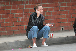 EXCLUSIVE: Jaime King takes a cigarette break outside a LA Studio and chat with her husband Kyle Newman while sitting on the curb of LA Street. Jamie was spotted sipping coffee off a mug featuring the logo of the Arsenal soccer team!. 31 May 2018 Pictured: Jaime King. Photo credit: FIA Pictures / MEGA TheMegaAgency.com +1 888 505 6342