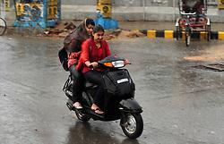 June 16, 2017 - Allahabad, Uttar Pradesh, India - Girls drive scooty during rain shower in Allahabad. (Credit Image: © Prabhat Kumar Verma via ZUMA Wire)