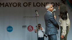 © Licensed to London News Pictures. 09/07/2016. London, UK. London's first Muslim Mayor of London,  Sadiq Khan, takes a selfie with BBC TV presenter, Konnie Huq, on stage at the EID festival in Trafalgar Square. Photo credit : Stephen Chung/LNP