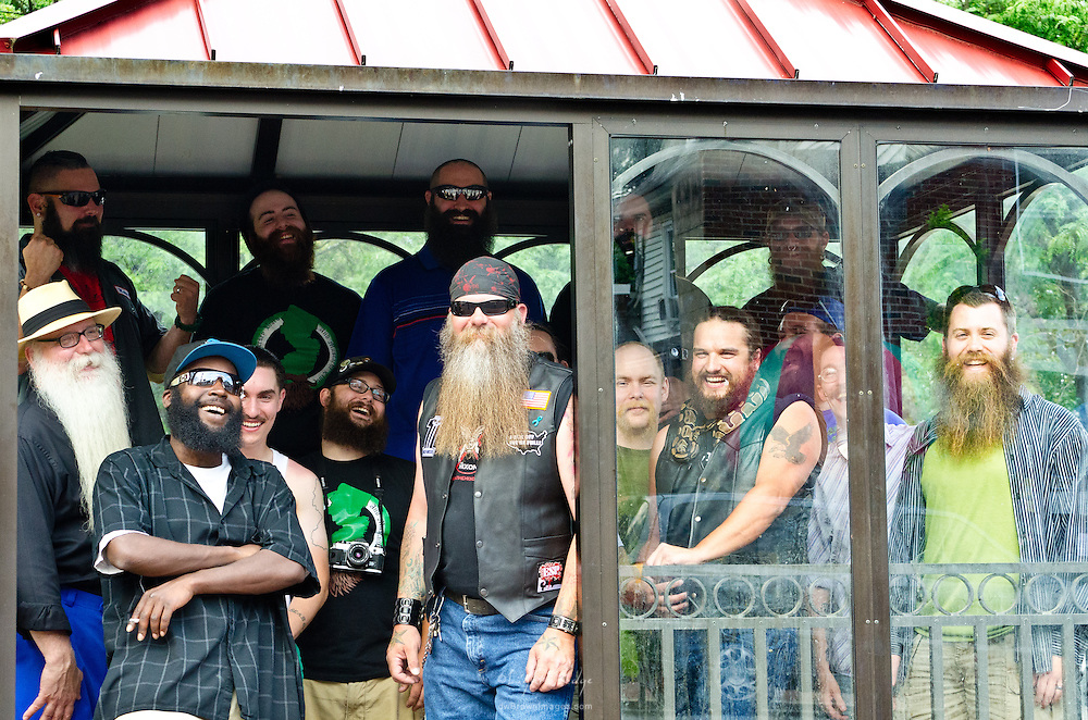 Contestants from the first Uptown Pitman Beard & Moustache Competition packed into the bus stop for a group shot.