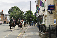 Tennis - 2021 All-England Championships - Week One - Wimbledon<br /> <br /> Horses ride through the village.<br /> <br /> COLORSPORT/ASHLEY WESTERN