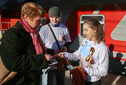 April 24, 2017 - Saint Petersburg, Russia - April 24, 2017. - Russia, Saint Petersburg. - Volunteers at Saint Petersburg's Moskovsky railway station hand out St. George ribbons as part of the annual campaign marking the 72nd anniversary of victory in the Great Patriotic War. (Credit Image: © Russian Look via ZUMA Wire)