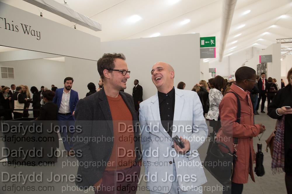 JONATHAN YEO ; STEVE LAZARIDES, The VIP preview of Frieze. Regent's Park. London. 16 October 2013