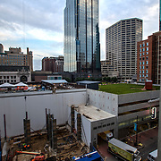 Early construction progress (June 2014) on the One Light Tower at 13th & Walnut Streets,  downtown Kansas City, Missouri. The first planned new-built residential component to the Cordish Company's Power and Light District. Humphreys and Partners Architects, Kushner Companies, co-developer. JE Dunn Construction, general contractor.