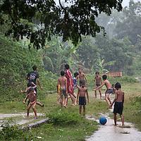 Kids playing along the bamboo train railway.