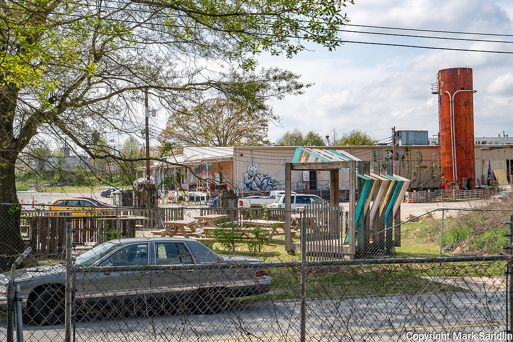 Bike riders, walkers, families and individuals enjoy spring blooms along the Atlanta Beltline. Westside Beltline runs behind homes, industrial parks and old warehouses sprouting business.
