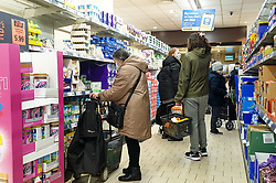 © Licensed to London News Pictures. 24/12/2020. London, UK. Shoppers just after 8am in Lidl supermarket in north London doing last minute shopping on Christmas Eve. The government has announced that a new COVID-19 mutation has been discovered in the UK in people who travelled from South Africa. As coronavirus continues to spread more areas will go into Tier 4 from Boxing Day. Photo credit: Dinendra Haria/LNP