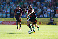 Joel Grant of Yeovil Town and Jem Karacan of Reading during the Skybet championship match, Yeovil Town v Reading at Huish Park in Yeovil on Saturday 31st August 2013. <br /> Picture by Sophie Elbourn, Andrew Orchard sports photography,