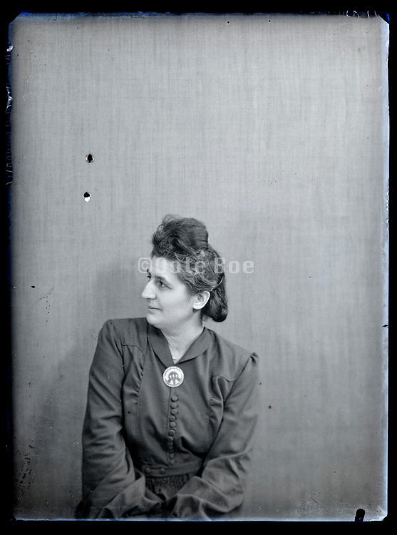 vintage studio portrait of a woman looking sideways, circa 1930s