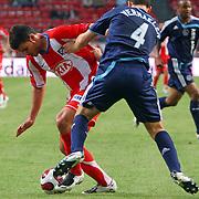 NLD/Amsterdam/20070802 - LG Amsterdams Tournament 2007, Ajax - Atletico Madrid, Braulio Nobrega Rodriguez in duel met Thomas Vermaelen