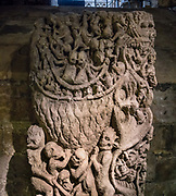 "Surviving from the 1100s Norman Minster, the Doomstone illustrates the Mouth of Hell (or Hell's cauldron), showing lost souls being boiled alive by demons. Its carved toads are creatures of magic associated with evil and darkness. Well-reserved limestone means it was protected indoors. You can see the Doomstone today in York Minster's undercroft and crypt. York Minster, built over 250 years 1220-1472 AD, is one of the finest medieval buildings in Europe. Also known as St Peter's, its full name is ""Cathedral and Metropolitical Church of St Peter in York,"" located in England, United Kingdom, Europe. York Minster is the seat of the Archbishop of York, the second-highest office of the Church of England. ""Minster"" refers to churches established in the Anglo-Saxon period as missionary teaching churches, and now serves as an honorific title. York was founded by the Romans as Eboracum in 71 AD. As the center of the Church in the North, York Minster has played an important role in great national affairs, such as during the Reformation and Civil War. This image was stitched from 3 overlapping photos."
