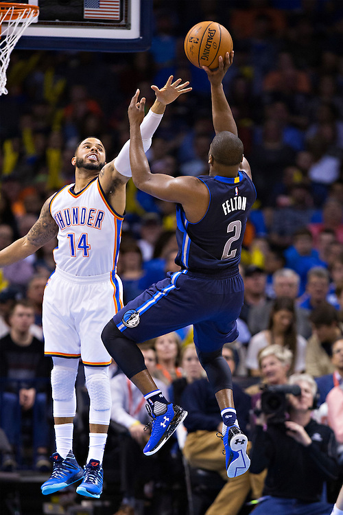 OKLAHOMA CITY, OK - JANUARY 13:  Raymond Felton #2 of the Dallas Mavericks shoots a jump shot over D.J. Augustin #14 of the Oklahoma City Thunder at Chesapeake Energy Arena on January 13, 2016 in Oklahoma City, Oklahoma.  NOTE TO USER: User expressly acknowledges and agrees that, by downloading and or using this photograph, User is consenting to the terms and conditions of the Getty Images License Agreement.   The Thunder defeated the Mavericks 108-89.  (Photo by Wesley Hitt/Getty Images) *** Local Caption *** Raymond Felton; D.J. Augustin