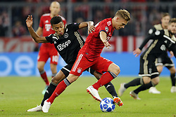 (l-r) David Neres of Ajax, Joshua Kimmich of FC Bayern Munchen during the UEFA Champions League group E match between Bayern Munich and Ajax Amsterdam at the Allianz Arena on October 02, 2018 in Munich, Germany
