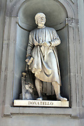 Statue located outside of the Uffizi museum in Florence, Italy. One of the oldest art museums in the Western World. Semi enclosed figurative statues such as this appear all over Florence. Statue of the artist Donatello.