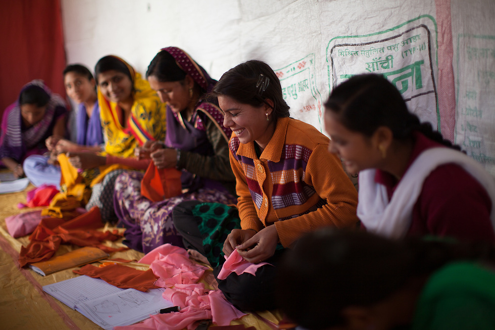 Women learn to be seamstresses in a three-month course supported by Fairtrade premium in Madhya Pradesh. The women want to set up small business in their villages. <br /> <br /> Fairtrade Australia and New Zealand support cotton producer groups in India. Fairtrade-certified groups benefit from Fairtrade through guaranteed prices for their produce, technical assistance to improve quality and output, and the Fairtrade premium which the producer groups decide what to do with, often using it for education and health care for their members' communities.
