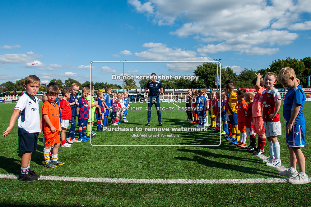 BROMLEY, UK - SEPTEMBER 08: The soccer school get ready to welcome the teams onto the pitch before the Emirates FA Cup First Qualifying Round match between Cray Wanderers FC and Bedfont Sports Club at Hayes Lane on September 8, 2019 in Bromley, UK. <br /> (Photo: Jon Hilliger)