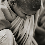 Artistic image of Buddhist monk in Northern India, praying and chanting.
