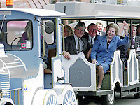A wave from Prime Minister Margaret Thatcher as she travels by fairground type  train from the Bournemouth Conference Centre to her hotel during the Conservative Party's annual conference in October 1990. This was to be the last party conference she attended as prime minister. Sitting beside her is Kenneth Baker, MP, Chancellor of the Duchy of Lancaster. Immediately behind and between them is Peter Morrison, Mrs Thatcher's Parliamentary Private Secretary. 19901049MT5<br /> <br /> Copyright Image from Victor Patterson, 54 Dorchester Park, Belfast, UK, BT9 6RJ<br /> <br /> t1: +44 28 9066 1296 (from Rep of Ireland 048 9066 1296)<br /> t2: +44 28 9002 2446 (from Rep of Ireland 048 9002 2446)<br /> m: +44 7802 353836<br /> <br /> victorpatterson@me.com<br /> www.victorpatterson.com<br /> <br /> Please see my Terms and Conditions of Use at victorpatterson.com . It is IMPORTANT that you familiarise yourself with them.<br /> <br /> Images used on the Internet incur an additional cost and must be visibly watermarked i.e. ©Victor Patterson within the body of the image and copyright metadata must not be deleted. Images used on the Internet have a size restriction of 4kbs and are chargeable at rates available at victorpatterson.com.<br /> <br /> This image is only available for the use of the download recipient i.e. television station, newspaper, magazine, book publisher, etc, and must not be passed on to any third party. It is also downloaded on condition that each and every usage is notified within 7 days to victorpatterson@me.com<br /> <br /> The right of Victor Patterson to be identified as the author is asserted in accordance with The Copyright Designs And Patents Act (1988). All moral rights are asserted.