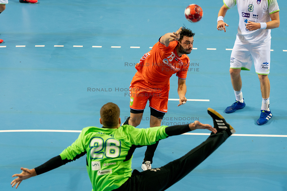 The Dutch handball player Samir Benghanem in action against Klemen Ferlin from Slovenia during the European Championship qualifying match on January 6, 2020 in Topsportcentrum Almere