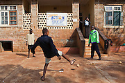 Some of the older boys play with a ball outside the Interim Care Centre in Thika, Kenya that is run by AFCIC – Action for children in conflict. AFCIC help children who have been affected by various forms conflict or crisis.