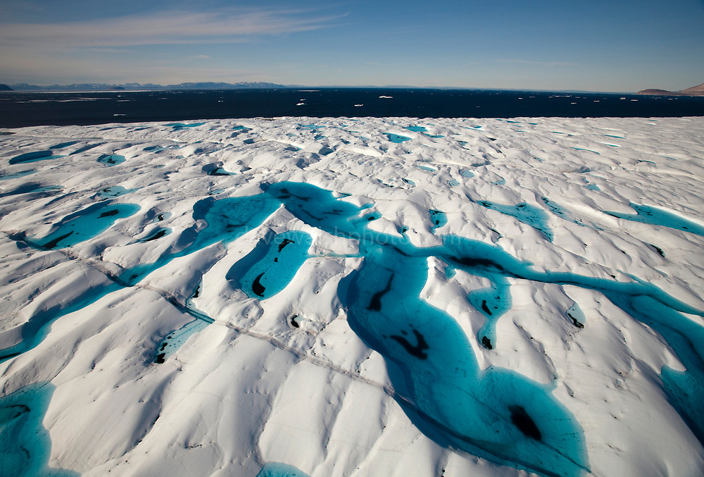 Aerial views of Melt Pools and melt rivers on Petermann Glacier, in remote northwest Greenland. The 80km long, 20km wide floating tongue of Petermann Glacier currently accounts for about 10% of the output of ice from Greenland's Ice Cap. In 2010 and 2012 Petermann calved ice islands totalling 400 square kilometres.