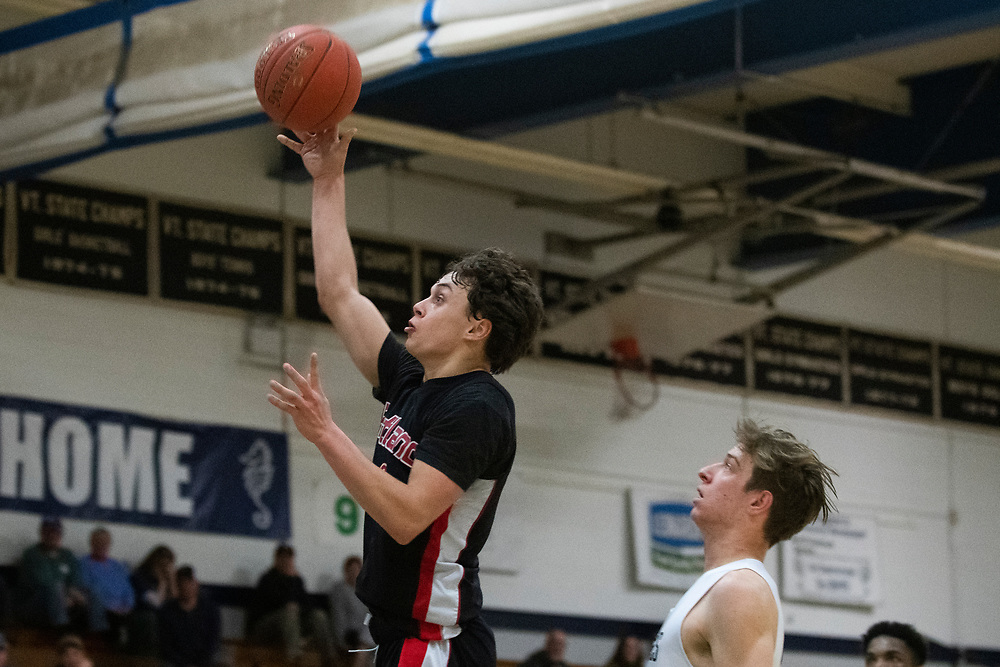 Rutland's Evan Pockette (10) leaps for a layup during the boys basketball game between the Rutland Raiders and the Burlington Seahorses at Burlington High School on Tuesday night February 25, 2020 in Burlington, Vermont. (BRIAN JENKINS/for the FREE PRESS)