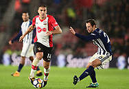 Oriol Romeu of Southampton (l)  in action .Premier league match, Southampton v West Bromwich Albion at the St. Mary's Stadium in Southampton, Hampshire, on Saturday 21st  October 2017.<br /> pic by Bradley Collyer, Andrew Orchard sports photography.