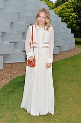 POPPY JAMIE at a party hosted by fashion store COS to celebrate The Serpentine Park Nights 2016 held at The Serpentine Gallery, Kensington Gardens, London on 12th July 2016.
