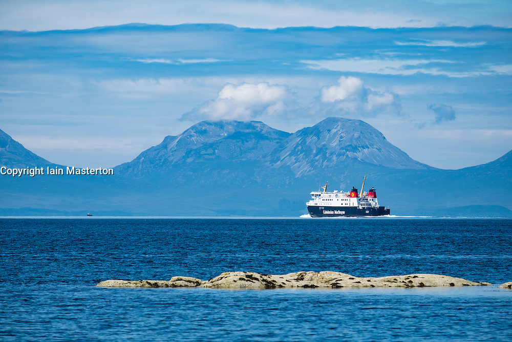 View of The Paps of Jura mountains on the Island of Jura and CalMac passenger ferry from Kintyre Peninsula in Argyll and Bute , Inner Hebrides,Scotland , United Kingdom