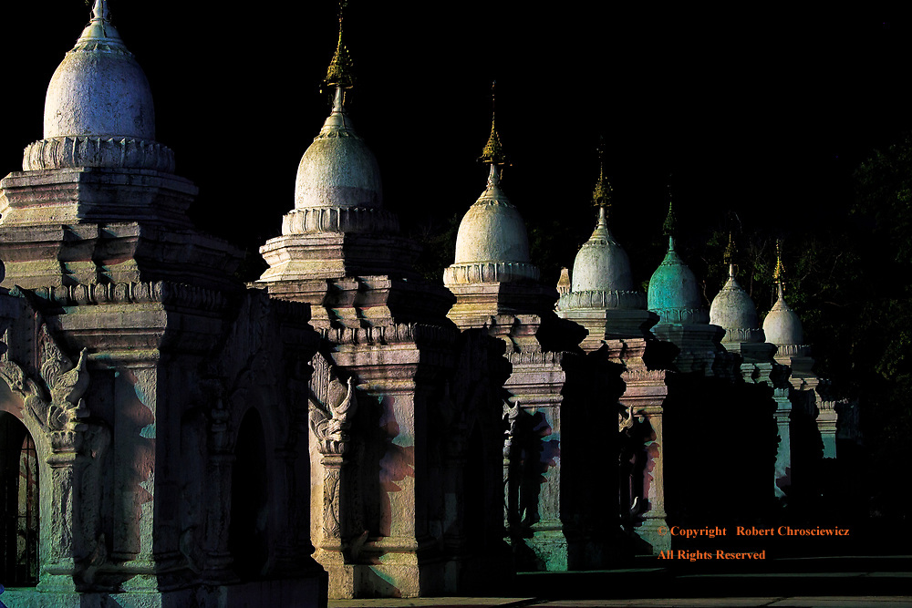 Kuthodow Moon Light: This row of Kyauksa Gu take on the air of fantasy as they display numerous pastels under a radiant moonlight, Kuthodaw Pagoda, Mandalay Myanmar.