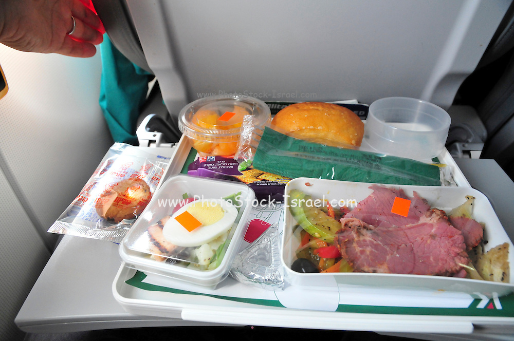 Food try served to economy class passengers during an international flight