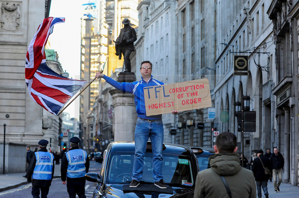© Licensed to London News Pictures. 17/01/2017. London, UK. Hundreds of black cab taxi drivers stage a protest, in the heart of the City of London, outside the Bank of England, demonstrating against part-pedestrianisation plans, which will limit the amount of vehicular traffic in the area. Photo credit : Stephen Chung/LNP