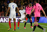 Kyle Walker-Peters of England and Chris Cadden of Scotland contest a loose ball during the U21 UEFA EURO first qualifying round match between England and Scotland at the Riverside Stadium, Middlesbrough, England on 6 October 2017. Photo by Paul Thompson.