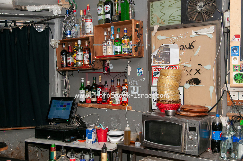 various bottles of alcohol on display in a bar. Photographed in Florentine Neighbourhood Tel Aviv, Israel