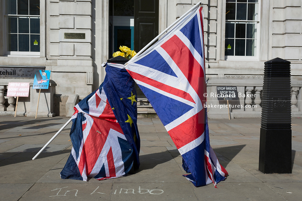 Brexit protest flags outside the Cabinet Office on Whitehall, the location of daily Brexit contingency planning meetings (codenamed Yellowhammer, in government departments), on 19th August 2019, in London, England.