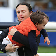 NORTH SALEM, NEW YORK - May 15: Georgina Bloomberg with her son Jasper while walking the course before competition during The $50,000 Old Salem Farm Grand Prix presented by The Kincade Group at the Old Salem Farm Spring Horse Show on May 15, 2016 in North Salem. (Photo by Tim Clayton/Corbis via Getty Images)