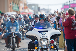 A police escort leads riders off of the Atlantic City boardwalk moments after leaving the start of the Motorcycle Cannonball Race of the Century. Stage-1 from Atlantic City, NJ to York, PA. USA. Saturday September 10, 2016. Photography ©2016 Michael Lichter.