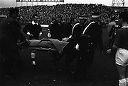 25/04/1965<br /> 04/25/1965<br /> 25 April 1965<br /> F.A.I. Cup Final: Shamrock Rovers v Limerick at Dalymount Park, Dublin. Limerick player Doyle who was seriously injured during the game being carried off the ground.