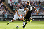 Fernando Llorente of Swansea city challenges Nemanja Matic of Chelsea.Premier league match, Swansea city v Chelsea at the Liberty Stadium in Swansea, South Wales on Sunday 11th Sept 2016.<br /> pic by  Andrew Orchard, Andrew Orchard sports photography.
