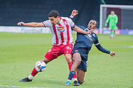 Stevenage defender Luther James-Wildin (2) and Morecambe Forward Carlos Mendes Gomes (11) battle for the ball during the EFL Sky Bet League 2 match between Stevenage and Morecambe at the Lamex Stadium, Stevenage, England on 6 February 2021.