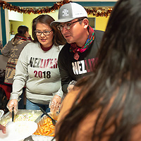 Deandra Wagner, 38, left, and J.T. Willie, 33, serve a dinner for the Nez/Lizer voters during the Navajo Nation Presidential election on Tuesday in Window Rock.